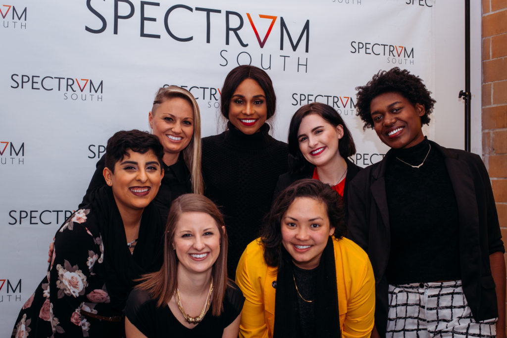 Spectrum South staff and Veer Queer co-hosts pose with the special guest of Spectrum South's Veer Queer Season 4 Live Kickoff, trans model and activist Jessica Zyrie.